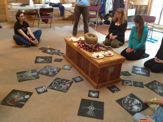Looking at our mandalas laid out on the floor next to stone medicine bowl.
